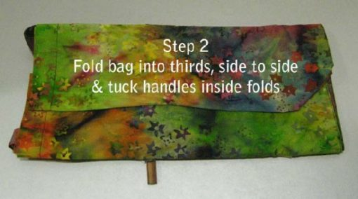 Step 2: Fold bag into thirds, side to side and tuck handles in.